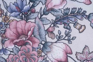Detail showing how designs on chintz were trimmed away from their background and applied to quilt top with a button hole stitch.