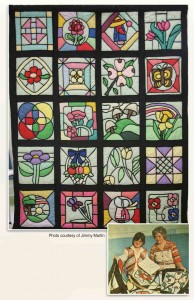 Stained Glass quilt--designs are appliqued to background in a way that maked it look like a stained glass window